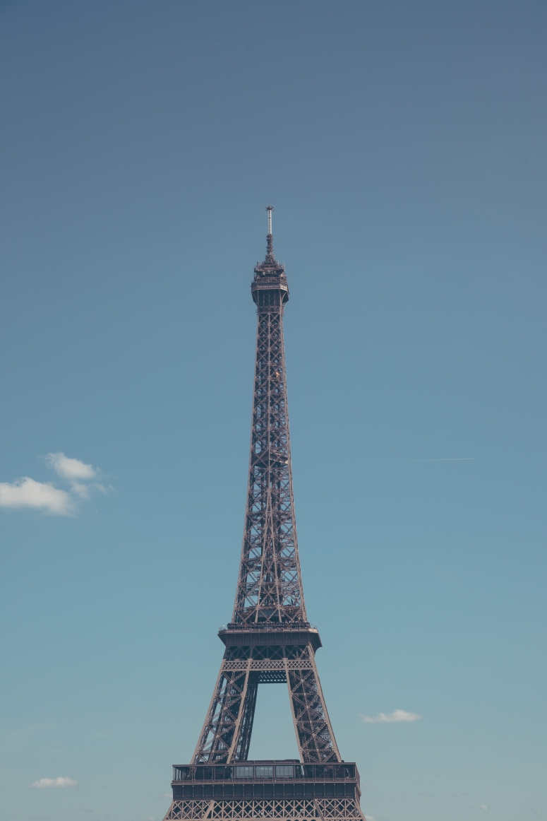 The Eiffel tower on a summers day in Paris.jpg